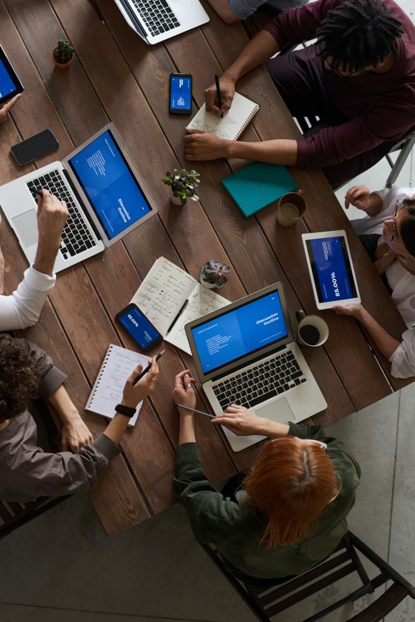 Image of the people working on laptops | Software Development Services | Ontrix