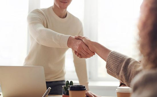 Image of the two people shaking hands | Website Maintenance | Ontrix