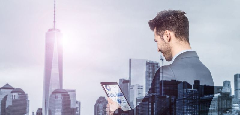 Image of the man looking at the tablet | Website Design Los Angeles | Ontrix